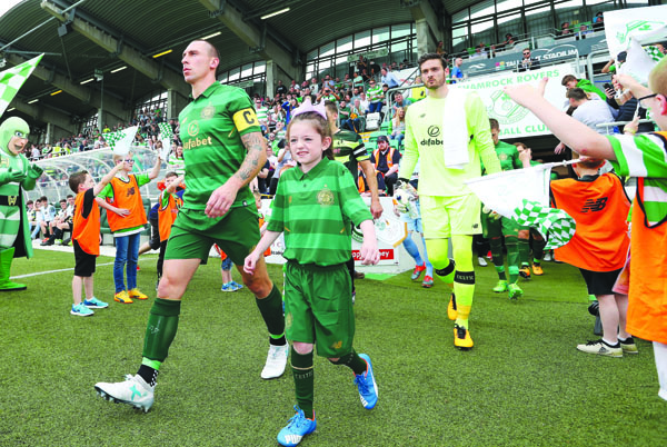 Celtic\'s Scott Brown leads his team out against Shamrock Rovers before last Saturday's 9-0 win at Tallaght Stadium. The Celtic skipper is expected to shake off an Achilles problem to feature against Linfield at Windsor Park on Friday evening
