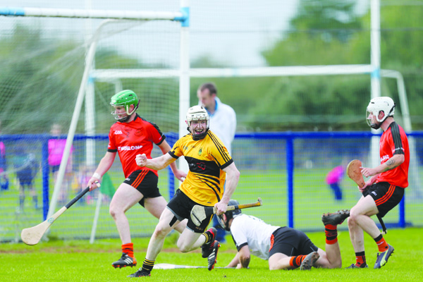 St Enda's forward Eoin Conlon wheels away after scoring a goal during last year's Antrim Intermediate Hurling final defeat to Cloughmills. The Glengormley side begin their 2017 Championship campaign against Armoy in Randalstown on Sunday
