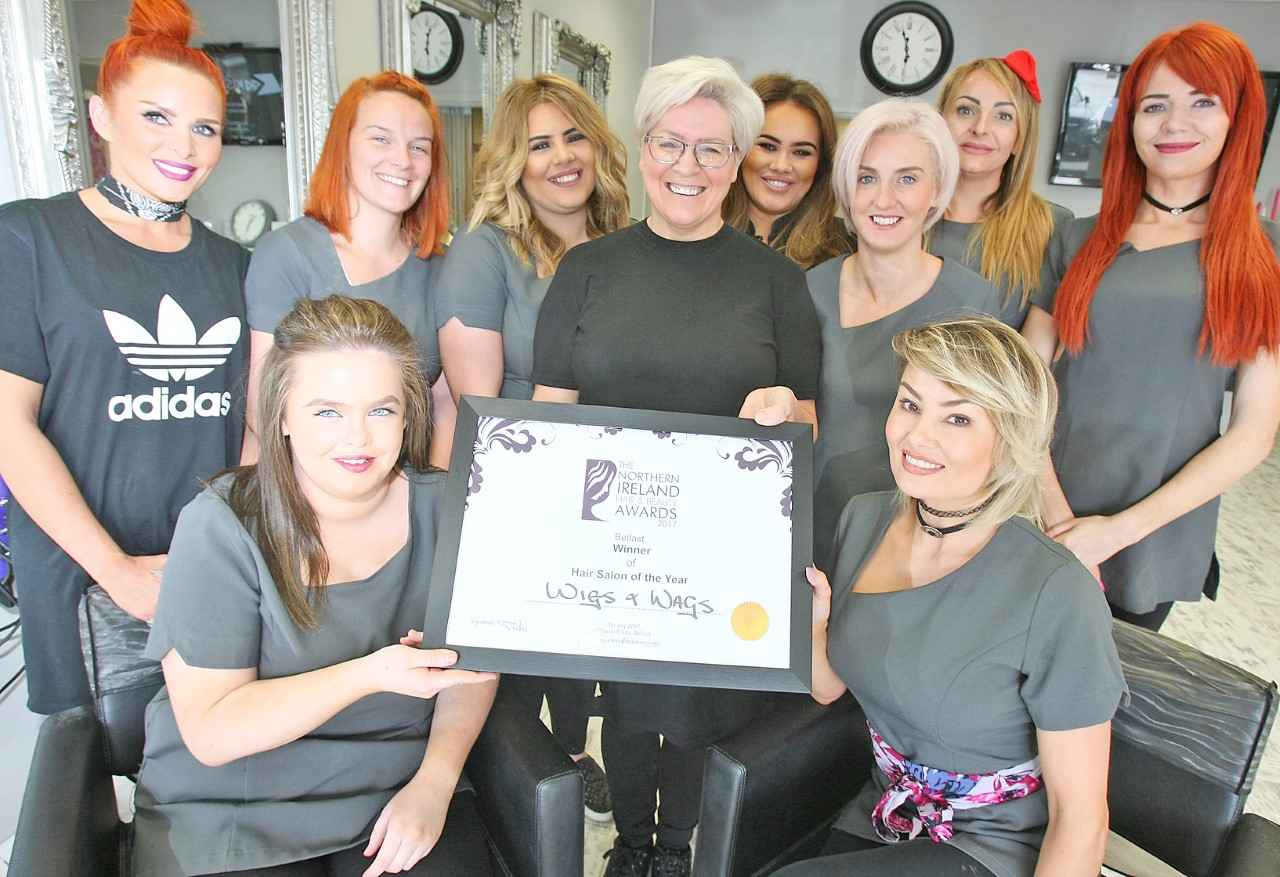 WELL DONE:Ann Bradley with the staff at Wigs & Wags with their Hair Salon of the Year award