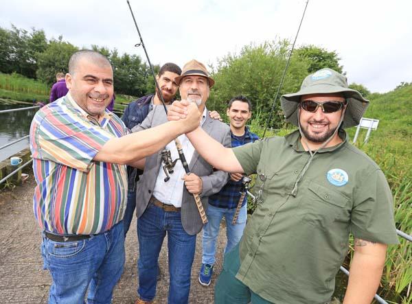 VISIT: Syrian visitors and hosts at the Half Moon Lake