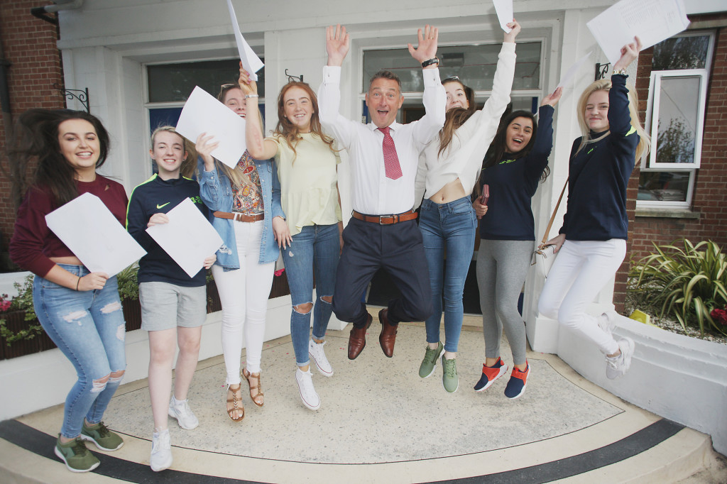 Head Teacher Martin Moreland celabreating GCSE results with Mercy College girls