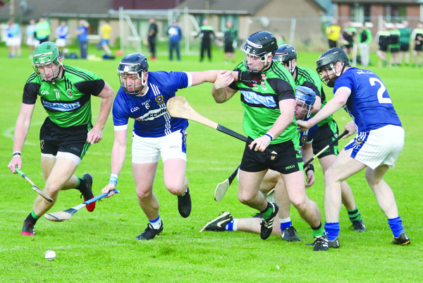 Action from last night's rearranged quarter-final as Sarsfield's overcame St Gall's to move into the semi-final against St Enda's