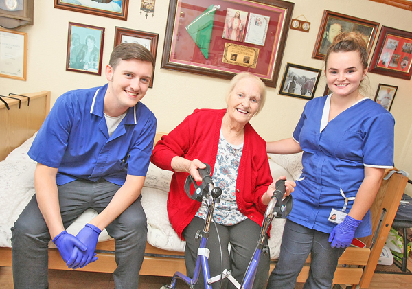 GREAT FAITH:Ballymurphy resident Alice Toner with Colin Care staff Ruairi and Megan
