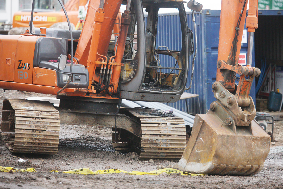 PROTECTION RACKET: A digger burnt out at a North Queen Street building site in 2015
