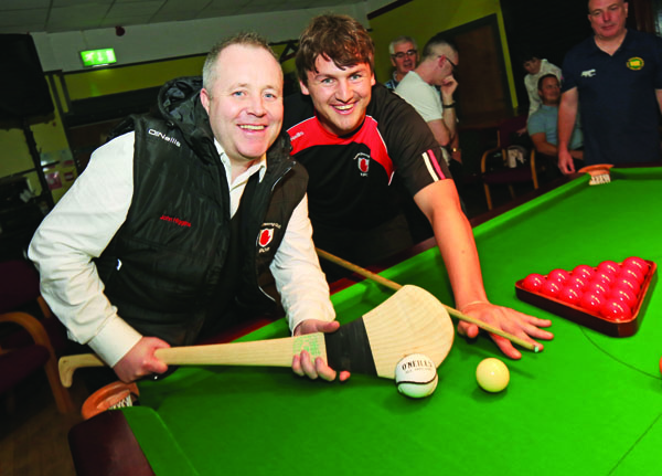 John Higgins swaps his snooker cue for a hurling stick with Lámh Dhearg senior, Domhnall Nugent