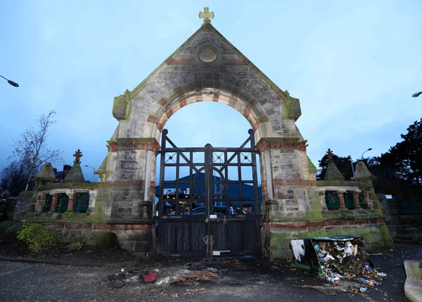 The morning after – the charred remains of the Milltown Cemetery gates