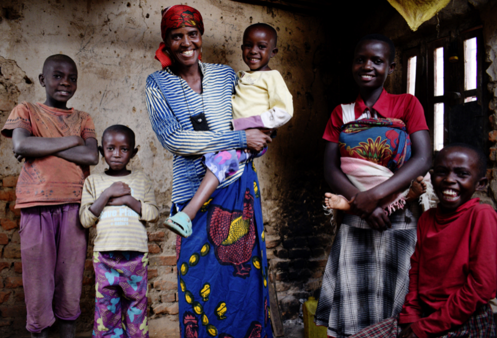 NEW HOPE: Violette Bukeyeneza in her dilapidated home with children Alain (11), Idrissa (7), Rachid (5), Amida (13) and Seraphine (10). With the help of Concern Violette has started a small business selling banana juice twice a week – and has earned enough to buy a goat; she now has plans to convert her front room into a small grocery shop when her home renovation is completed