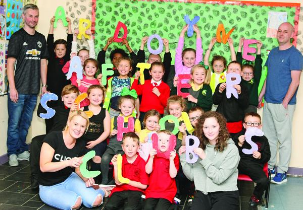 Ardoyne After-Schools Club children with staff members Damien Sparks, Paul Toner, Leanne Faulkner and Jessica Flynn