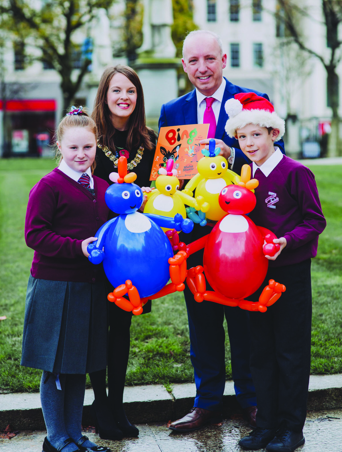 FESTIVE: The Lord Mayor of Belfast, Councillor Nuala McAllister, joins Cavehill Primary School pupils Anna Adams and Finn Bryan and Principal Stephen Orr in looking forward to the Christmas lights switch-on, which takes place on Saturday, November 18