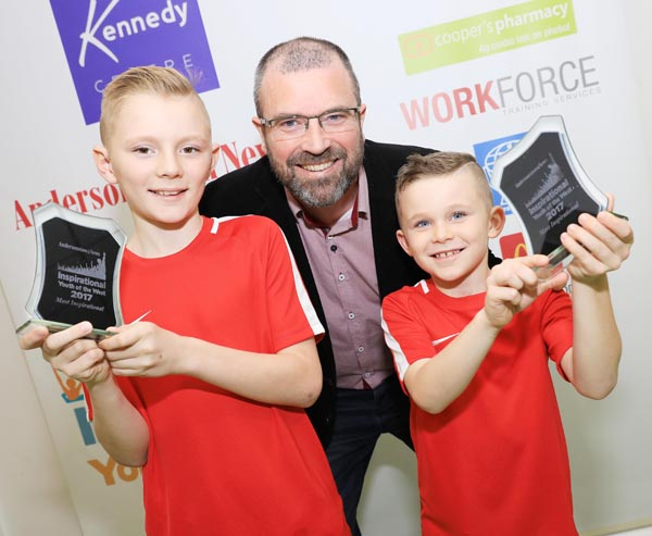 Tom and Martin McIlwaine, winners of the Most Inspirational Youth award, with John Jones of event premier sponsors the Kennedy Centre
