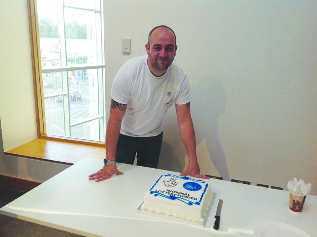Ardoyne Youth Club leader Thomas Turley celebrates the National Lottery funding