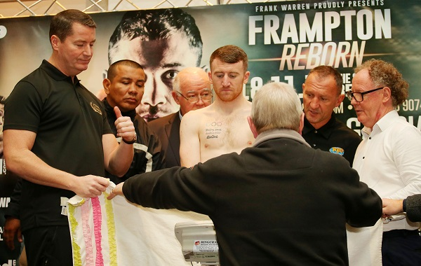 Paddy Barnes is protected by a towel as he removes his underwear to make the weight. \n\nPicture by Jonathan Porter/PressEye.com