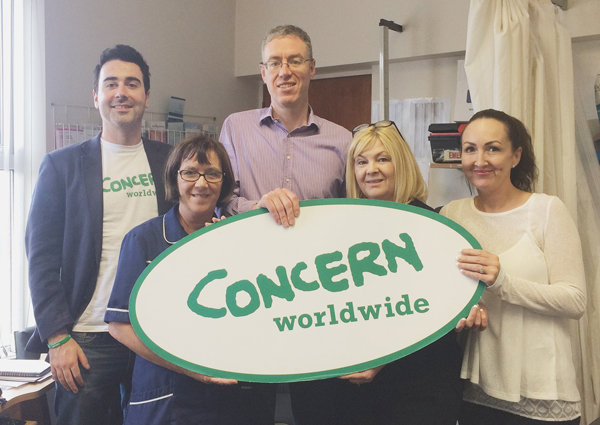 Dr Mark McCrory, middle, and Oldpark Road colleagues Ann Neeson, Margaret McClenaghan-McCartan and Tina Kealey with Concern's Eoin Duffy