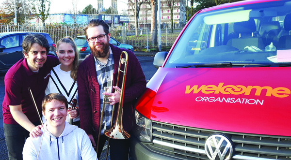 TOGETHER:Paul McCusker, Lucy Addy and Nathan Moore from Laganside Sinfonia with Kieran Hughes from The Welcome Organisation
