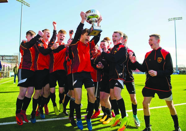 De La Salle capt Calvin McCurry celebrates with his team after their victory over Edmund Rice during the u16 schools cup final at Seaview stadium in North Belfast.  Picture Mark Marlow