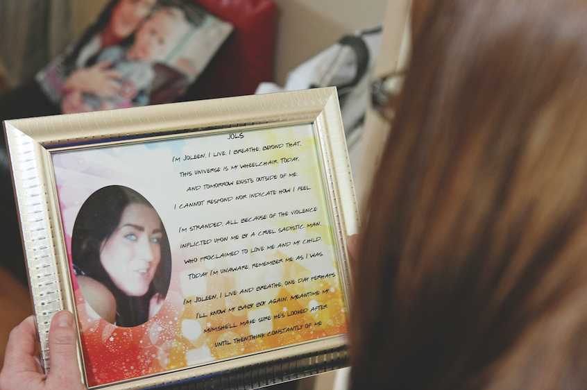 Carol Corr looks at a photograph of her daughter Joleen