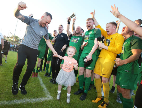 Lucky mascot Anna Murphy celebrates with Crumlin Star players after the North Belfast outfit won the Clarence Cup on Tuesday night following a 3-0 victory against Sirocco Works at Breda Park