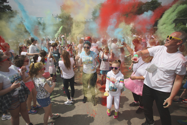 Sun and fun at the Friends of  St Teresa\'s Colour Run in Falls Park on Saturday morning