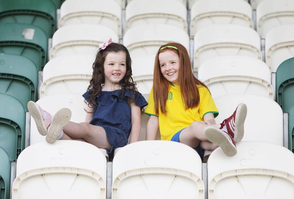 Watching a charity football game in honour of Macy Brady at the Donegal Celtic pitch from the cool of the shade  are cousins Eva Carville and Ruby Brady