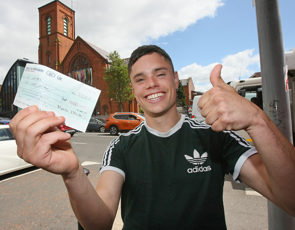 Naoise Ó Cairealláin gives the thumbs-up to vital funds boost for summer Irish language fest Liú Lúnasa. A £1000 donation from Gaeilge group An Nasc will ensure the summer celebration of all things edgy and Irish language goes ahead. Liú Lúnasa, which will feature Naoise's infamous rap duo Kneecap, will run from August 22 to 26