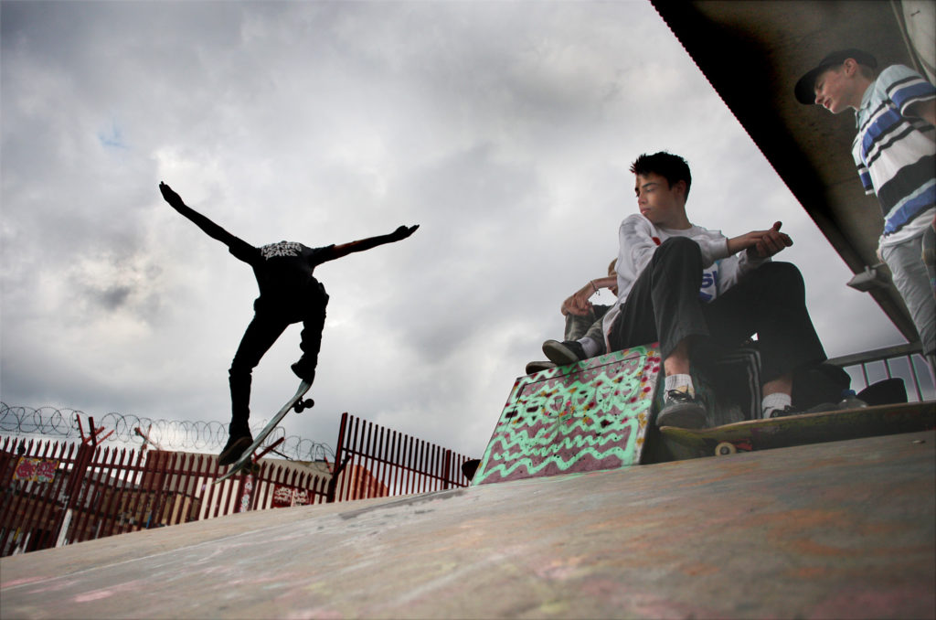 Flying under the flyover – skater boys hanging out in Little Patrick Street skate park underneath the M3