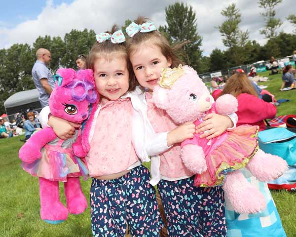 Éirinn and Róise Devlin with their favourite friends at Féile an Phobail's Teddy Bears Picnic in the Falls Park.