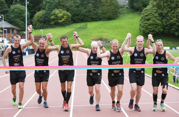 At the Mary Peters Track are Collie Drain, Michael Magee, Paul Tyrrell, Paul Magee, Brendan McNally, Noel McNally and Damian Grant after completing the  CCU32 – 32 marathons in 32 days