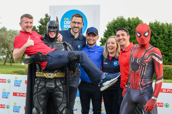 Sports stars and superheroes joined forces at the the Oscar Knox Cup to celebrate Wee Oscar's 10th birthday. The event, now in its third year, took place at Fortwilliam Golf Course with SPAR coming on board as sponsor for the 2018 event.  Oscar's parents Stephen and Leona are with Batman and Spiderman and Carl Frampton, Paddy Barnes and Jamie Conlan