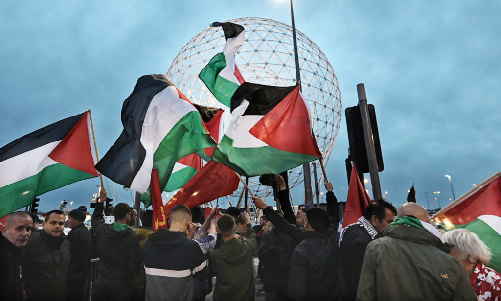 Pro-Palestine protestors at the Rise sculpture on Broadway Roundabout last night as Northern Ireland took on Israel in a friendly half a mile away at Windsor Park