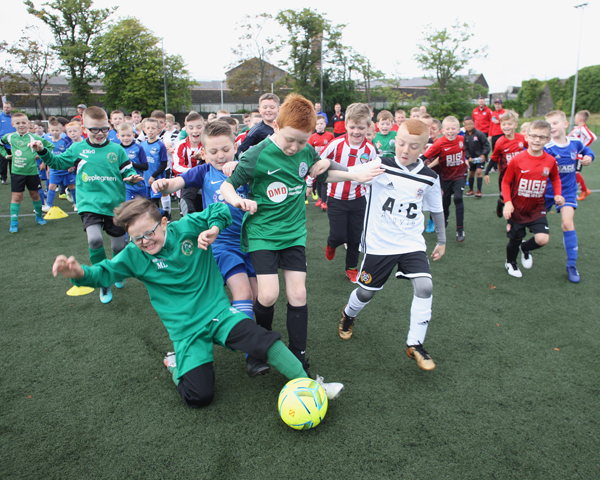 MY BALL: Taking part in a cross community football tournament at St Malachy's College Pitch on the Antrim Road