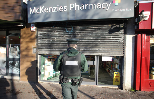 : Police at the scene of the chemists where a quantity of prescription drugs was stolen on Monday afternoon.