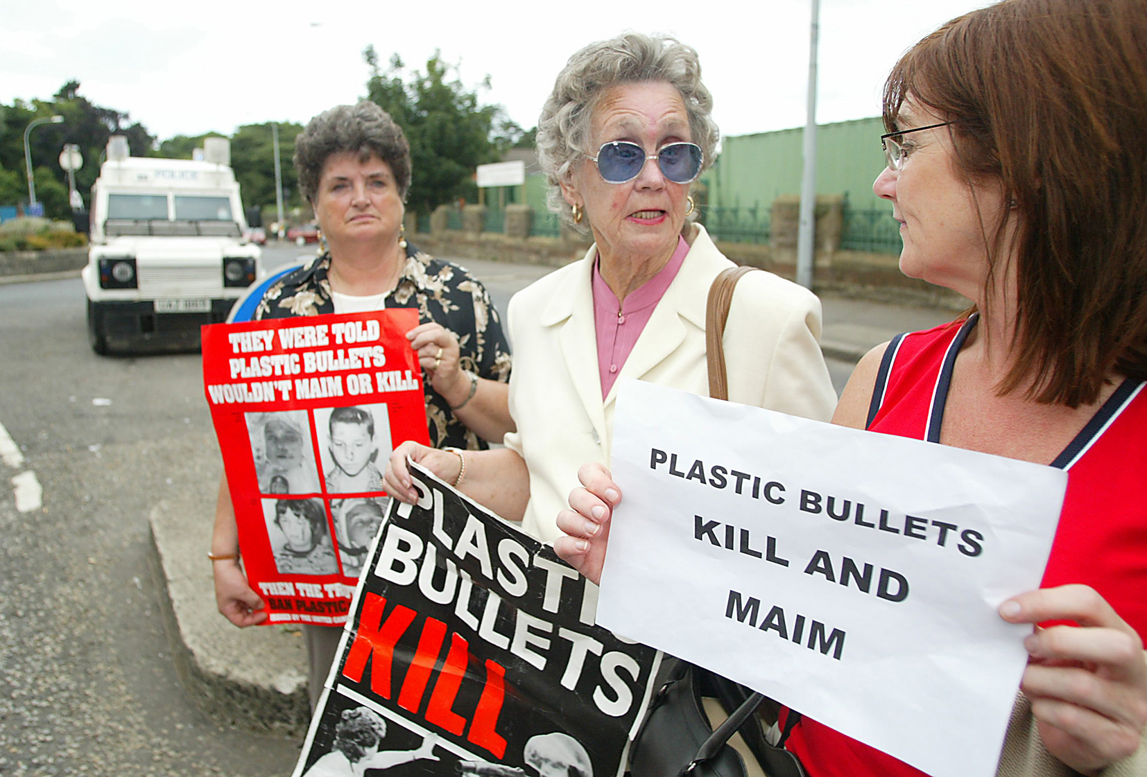 STANDING TOGETHER: Clara Reilly, left, Emma Groves and Elizabeth Livingstone at a plastic bullets vigil at the Andersonstown Barracks site