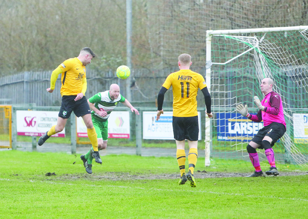 Martin McDonald heads the opening goal for St James' Swifts during last Saturday's remarkable 8-5 win over West Belfast rivals Donegal Celtic and new player/manager Dermot McVeigh insists his side must shore up their defence ahead of Saturday's trip to Dunloy FC