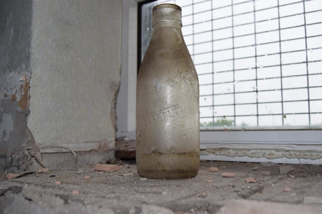 FIND:The milk bottle that was unearthed at the old St Thomas' Secondary School this week
