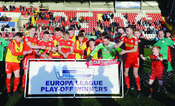 Cliftonville, pictured celebrating their 2-0 extra-time Europa League Play-Off victory over Glentoran at Solitude last month, have been drawn against Barry Town United in the preliminary round of the competition with the first leg scheduled for later this month
