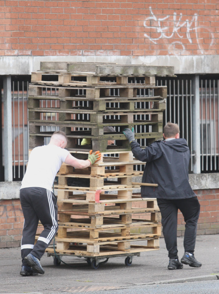 NUISANCE: Youths bring pallets given to them by local firms to the New Lodge using a borrowed trolley