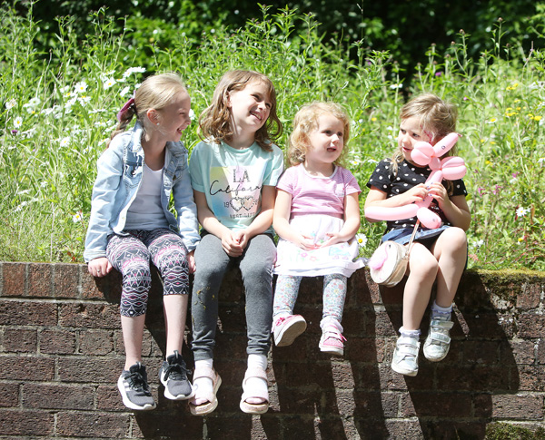 Taking a well-deserved break at the Ligoniel Glenbank Cross Community Garden, Clean Up and Fun Day are pals Jessica May Faulkner, Faith Ladurner Eve McGregor and Darcy McCullough