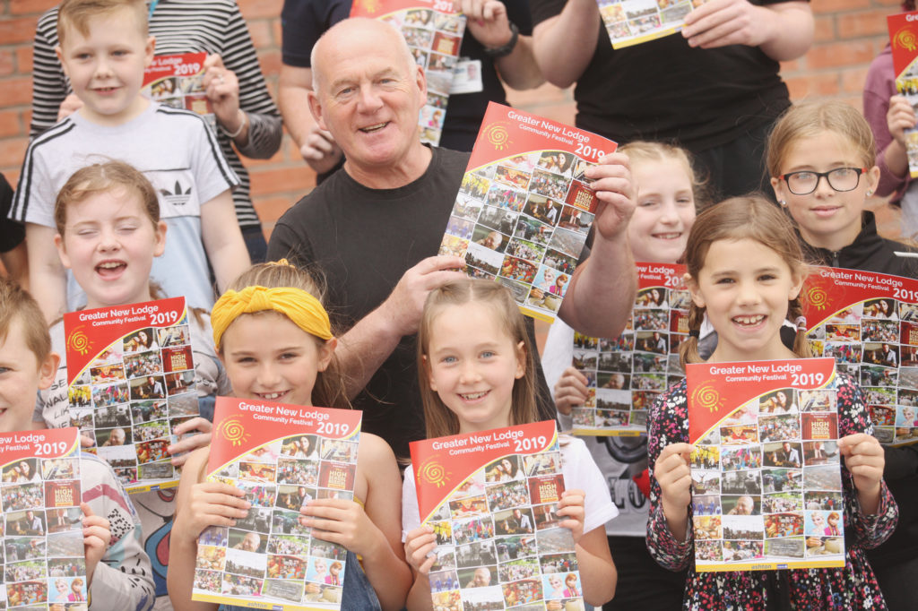 Paul O'Neill joins local children for the launch of the Greater New Lodge Community Festival at the Girdwood Community Hub