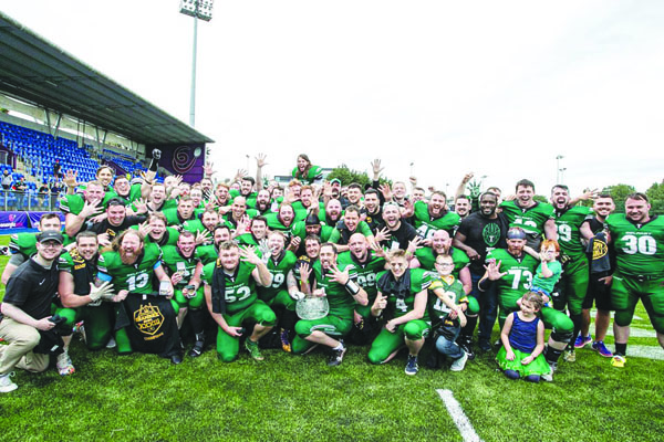 Belfast Trojans celebrate with young fans after their 24-10 win over South Dublin Panthers on Sunday