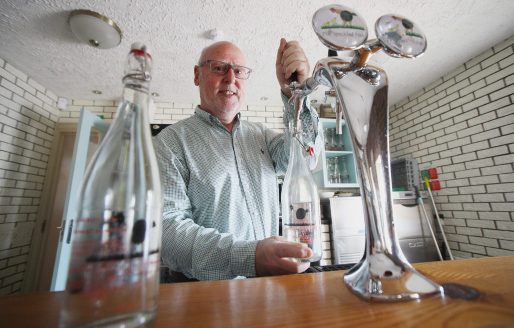 NOW THAT'S FRESH:Martin Caldwell serves up some of the crisp water at The Speckled Hen