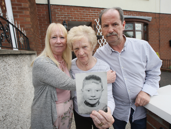 JUSTICE:Patrick Rooney's mother Alice with her son and daughter Con and Sharon, holding a photo of Patrick who was shot dead by the RUC in August 1969