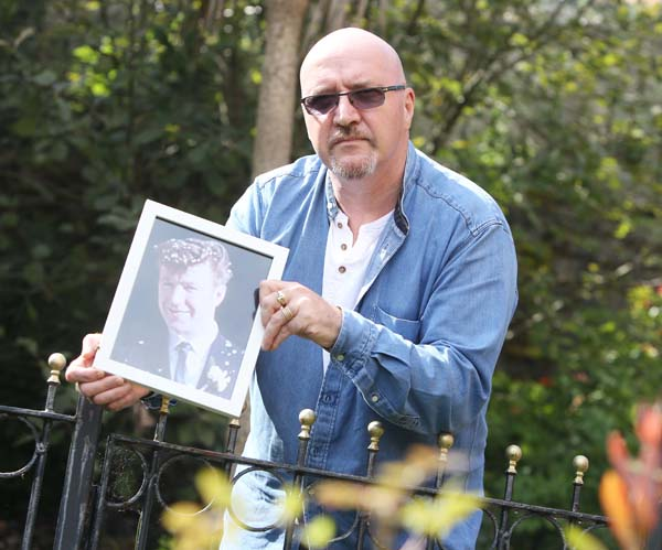 POGROM: Sam McLarnon with a picture of his father Samuel (27) murdered 50 years ago in August 1969