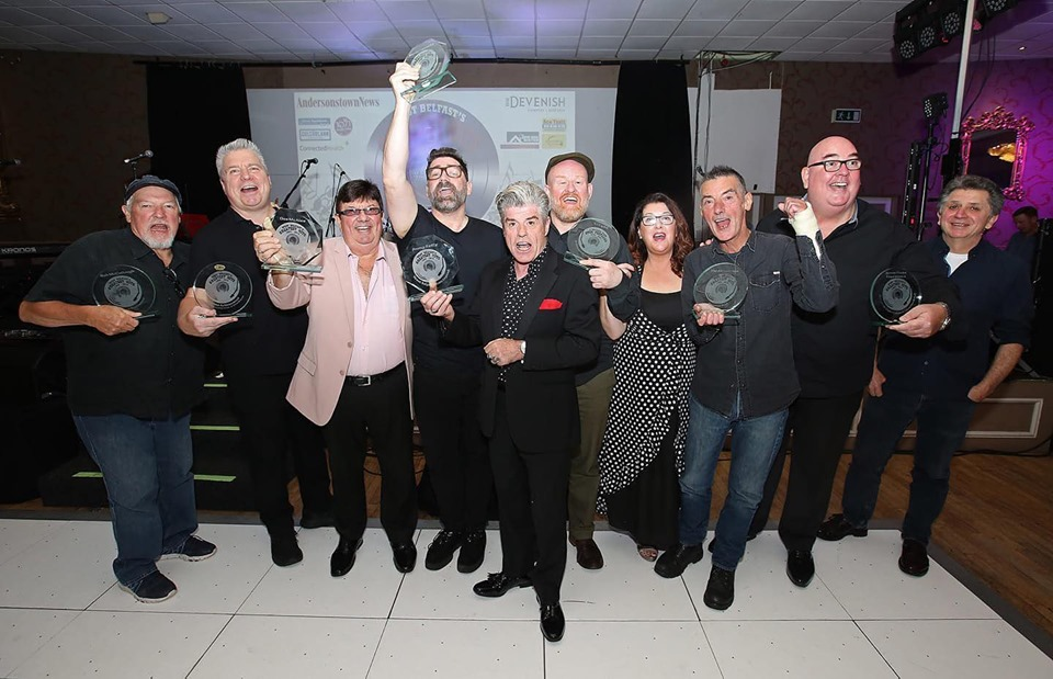 Rab McCullough, U105's Johnny Hero, Des Lee, Brian Kennedy, Joby Fox, Jimmy Reilly, The Adventures' Eileen and Pat Gribben, Terry Sharpe and James Peake celebrate their West Belfast Greatest Hits and Legends awards
