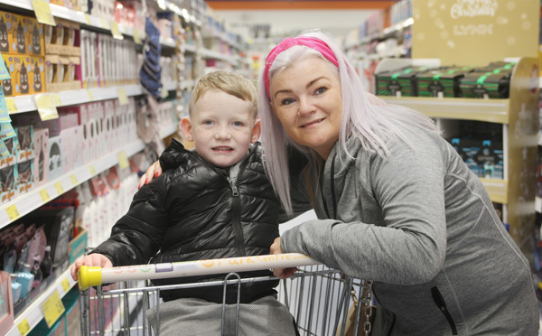 Karen Rainey and her nephew Bobby are one of the first customers as B&M open their new superstore in the Park Centre this morning creating 100 jobs