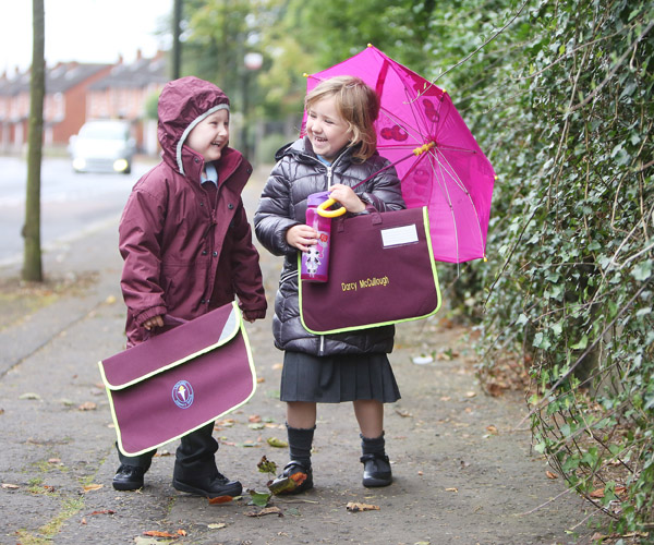 STORMY SCHOOL DAY: Ligoniel Primary School P1's Darcy McCullough and Carson Watson make their way to school this week