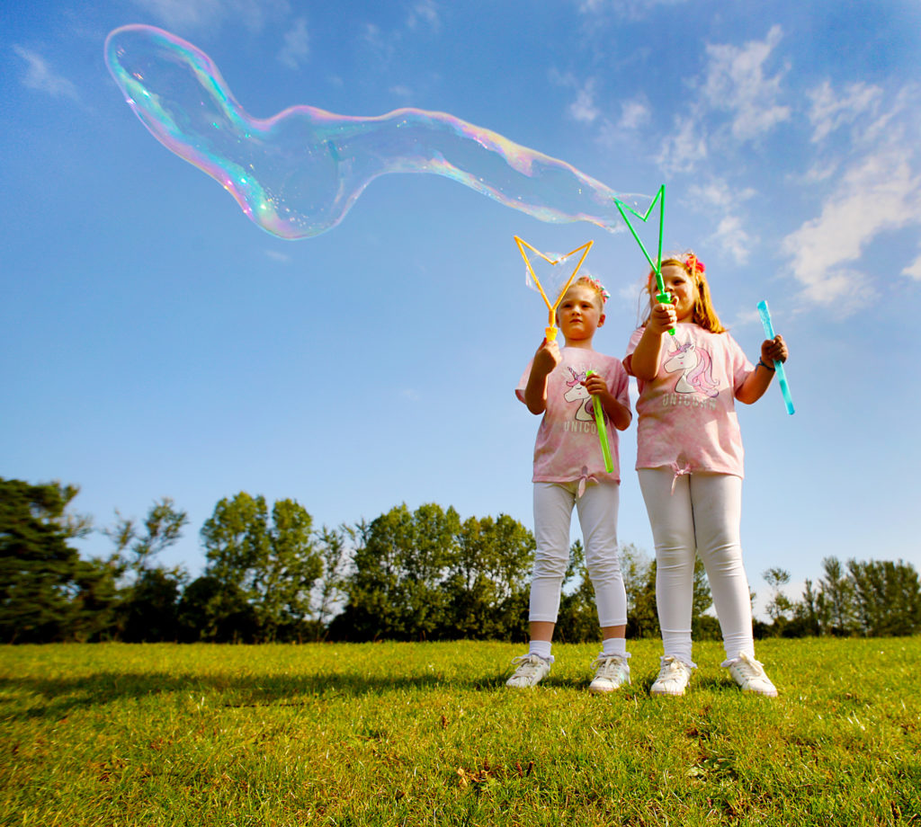 Double bubble in the Falls Park as sisters Mya and R—ise Parker enjoy the early summer sunshine
