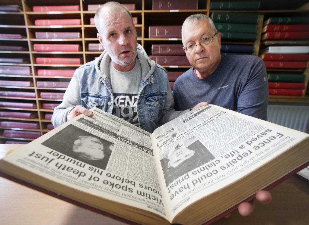 EVIDENCE: Paul Thompson's brother Eugene and Mike Ritchie of Relatives for Justice study Andersonstown News reports of the murder