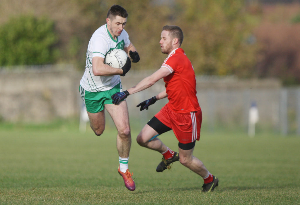 Action from the Ulster Intermediate Championship quarter-final clash between Aldergrove and St Naul's at Corrigan Park yesterday. The Donegal outfit emerged triumphant, with a goal separating the teams at the final whistle