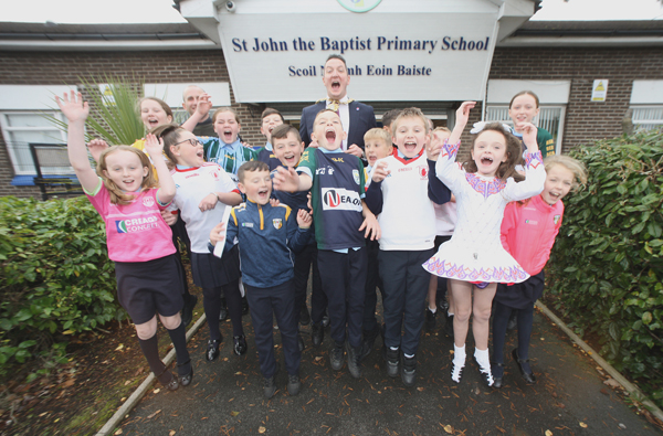 Belfast Lord Mayor John Finucane pays a visit to St John the Baptist Primary School\nin Finaghy and joined the pupils in raising a cheer