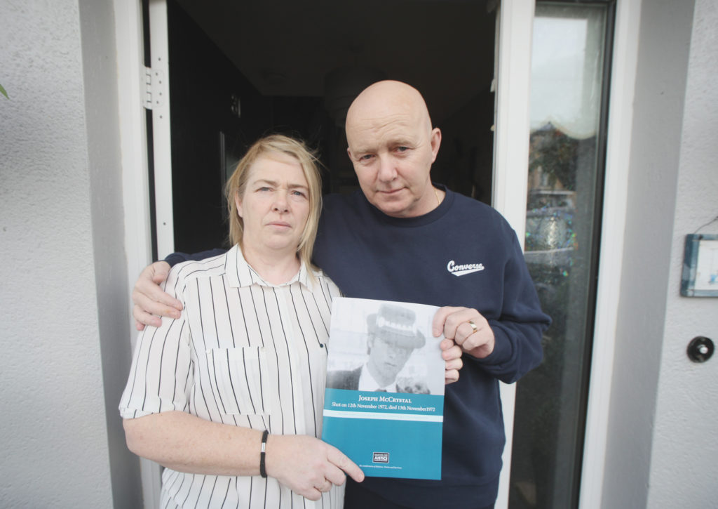 TOGETHER: Donna and Joe McCrystal holding the report into their father's murder
